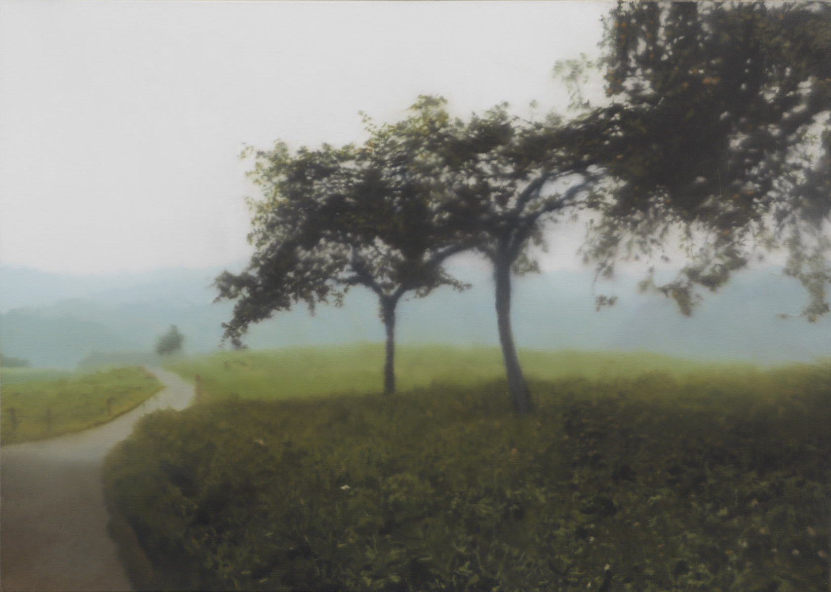 A painting of a grassy hilltop with trees and a road, hazy mountains in the distance, and a grey sky.