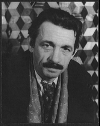 A black and white headshot-style photograph of Thomas Hart Benton dressed in a suit with a geometric background.